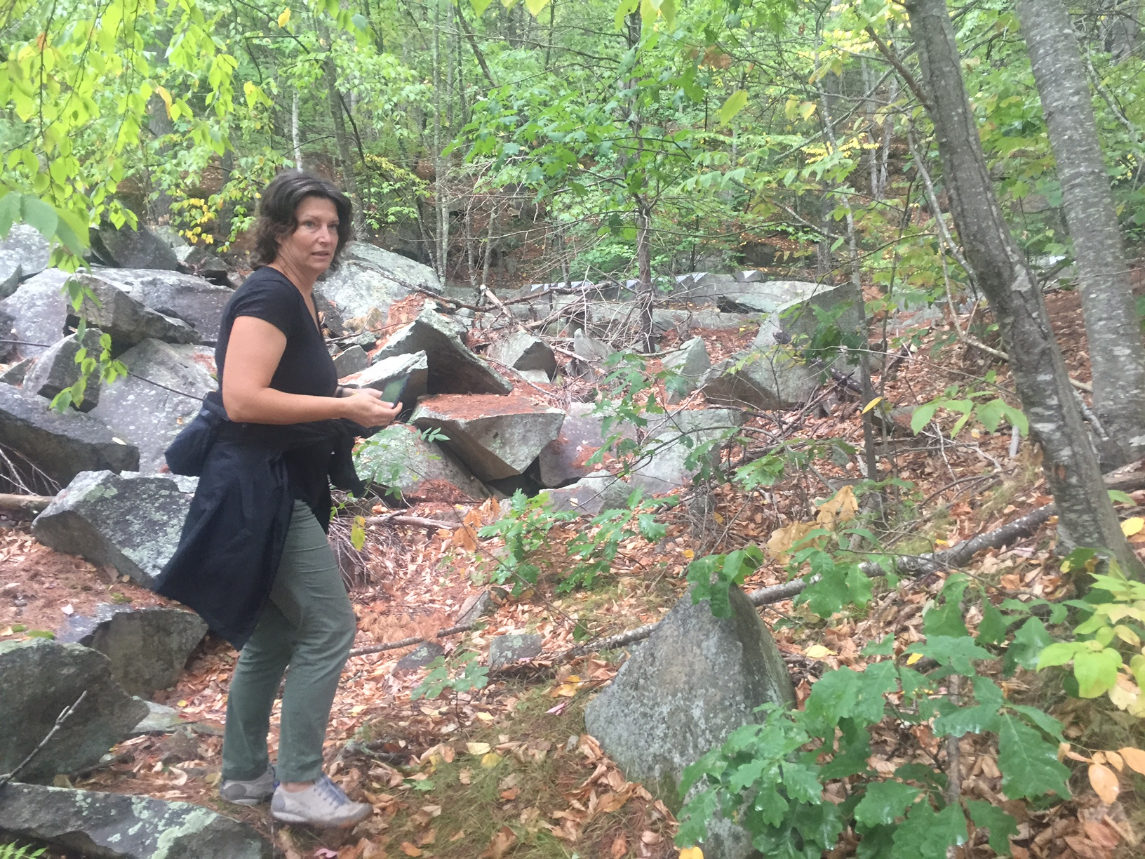 Participant, Dominika Griesgraber is hard at work locating the first half of her large granite sculpture
